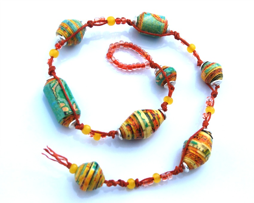 paper bead bracelet Mold extra scrapbook paper into distinctive beaded jewelry learn how on diynetworkcom.